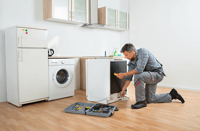 repairing a dishwasher in a home in Fall River
